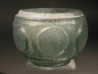 Sassanian bluish-green cut glass small bowl or pyxis.