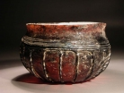 Early Roman purple glass ribbed bowl with white marvered trail