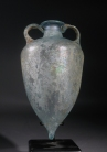 Roman light blue amphora with two handles and pointed base.