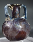 Roman purple glass aryballos with marbled blue glass handles