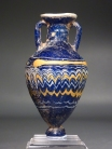 Eastern Mediterranean core-formed blue glass amphoriskos.