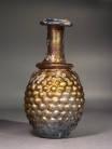 Roman molded golden amber glass ???Grapes??� flask.