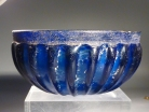 Early Roman blue glass ribbed bowl.